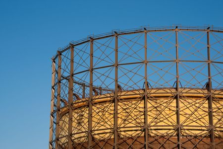 Detail of gas reservoir structure against clear blue sky under golden sunset light Stock Photo - 4223837