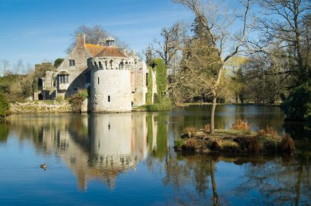mote: Scotney castle and mote with reflection against blue sky