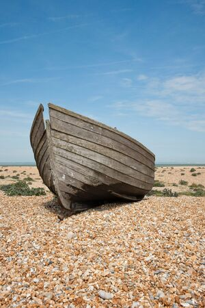 Abandoned shipwreck of wood fishing boat on beach against blue sky Stock Photo - 4863874
