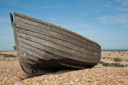 Abandoned shipwreck of wood fishing boat on beach against blue sky Stock Photo - 4863884