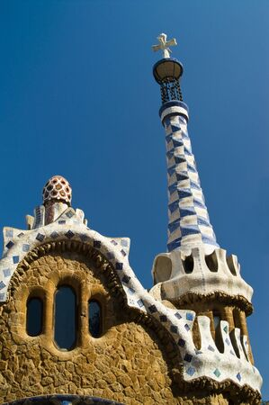 House designed by Gaudi in Park Guell against clear blue sky, Barcelona, Spain photo