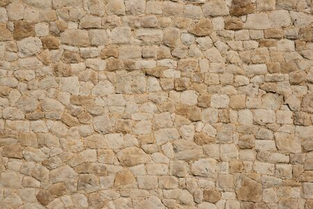 Old stone wall suitable as background with patterns and texture