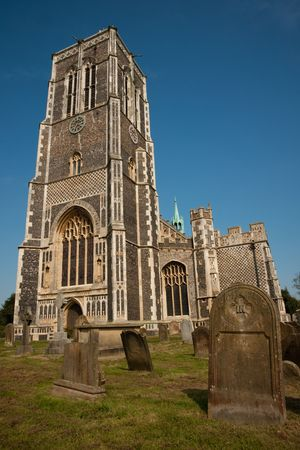 southwold: St. Edmunds church and gravewyard, Southwold, Suffolk, against clear blue sky Stock Photo