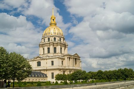 Les Invalides with garden in foreground against rich blue sky with fluffy clouds, Paris, France