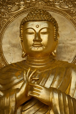 Close up of gold Budha statue in Peace Pagoda, Battersea Park, Wandsworth, London, UK