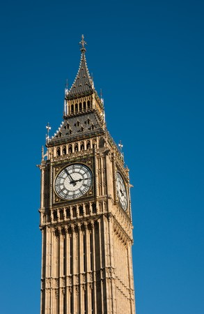 Detail of Palace of Westminster with Big Ben against deep blue sky