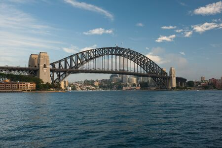 Sydney, Australia - 18 February 2011 : Sydney Harbour Bridge, early in the morning against blue sky with some white clouds