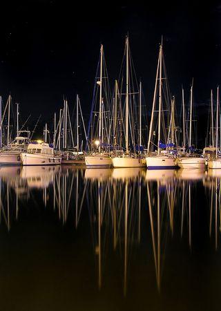 Boats at night photo