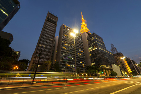 A view of Paulista avenue in the evening with the typical plaque with its name and the peculiar buildings of the financial center of São Paulo