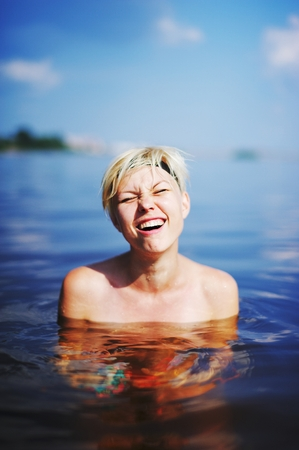 shoked: girl in cold water sea shoked Stock Photo