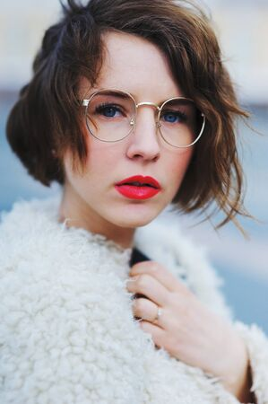 beautiful portrait of romantic a pensive girl in glasses
