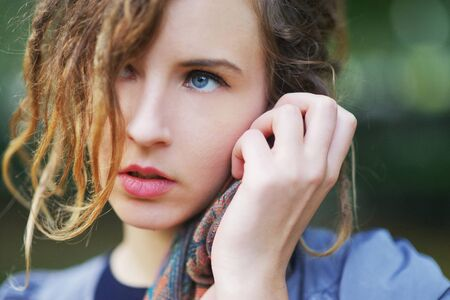fair complexion: portrait of a beautiful charming girl with expressive eyes in the Park in autumn day, close up.