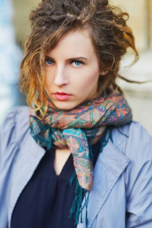 slavonic: Wonderful portrait of pretty slavonic girl with beautiful blue eyes in the street closeup. Stock Photo