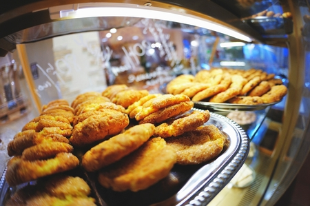 Delicious sweet pastries on a tray in the Windows, the beautiful blurred background with reflection Stock Photo