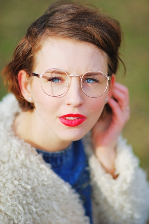 Portrait of young beautiful successful girls with glasses outdoor, closeup
