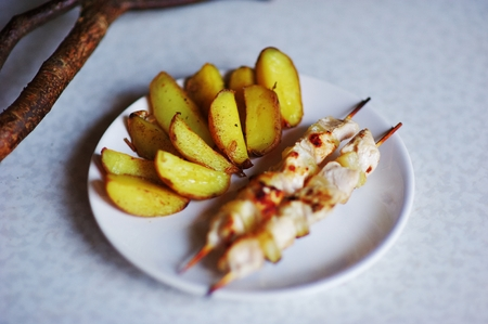 spit: Shashlik and fried potatoes on the table