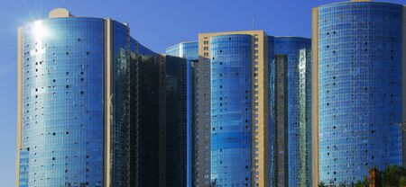windows: multi-storey residential complex. The sun is reflected in the windows Stock Photo