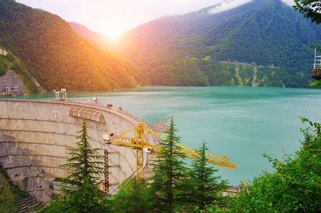 Scenic mountain landscape. Dam of Enguri - hydroelectric power station on Inguri river in Georgia.