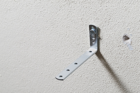 The bracket is fixed to the wall foam or aerated concrete with a screw