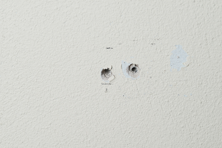 Two holes in the wall foam or aerated concrete for the installation of dowels for bolts Stok Fotoğraf