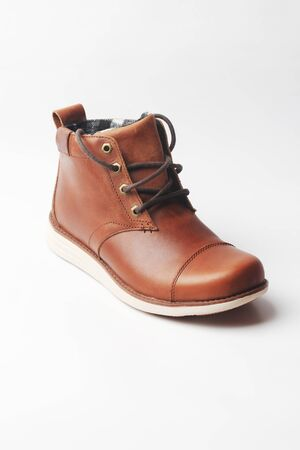 winter brown leather boots on a white background. Modern fashion and style. Closeup.