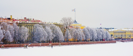 Russia. Scenic winter view of St. Petersburg. Frozen river. Promenade with beautiful snow covered trees and old architecture. Admiralty building and famous monument to Peter great - bronze horseman. Stock Photo
