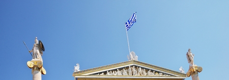 National Academy of Athens neoclassical building with Athena and Apollo statues. Iconic neoclassic Academy of Athens. historic center in Attica, Greece