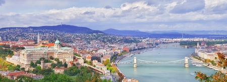 Budapest, Hungary. Beautiful aerial panoramic skyline view of historic Buda Castle Royal Palace sunrise blue sky clouds. Hungarian landmark Szechenyi Chain Bridge, Parliament building and Danube river 版權商用圖片