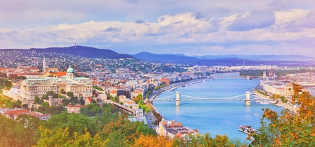 Budapest, Hungary. Beautiful aerial panoramic skyline view of historic Buda Castle Royal Palace sunrise blue sky clouds. Hungarian landmark Szechenyi Chain Bridge, Parliament building and Danube river 免版税图像