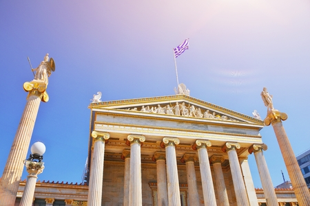 National Academy of ancient Athens neoclassical building with Athena and Apollo statues. Iconic neoclassic Greek Academy of Athens. Landmark in historic center of Attica, Greece, Europe