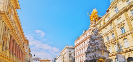 Pestsaule on Graben, a famous pedestrian street of Vienna with a Memorial Plague Column. old town main street in Vienna, capital of Austria. Beautiful travel picture on Vienna autumn. Blue skyline