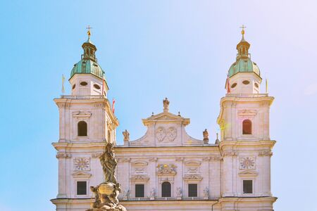 Famous Salzburg Cathedral, Salzburger Dom, at Domplatz in City Center of Salzburg Land, Austria on sunny day. Baroque roman catholic church and Marien Statue monument on square Beautiful architecture.