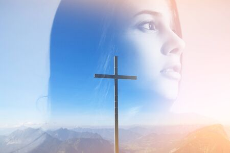 Double multiply exposure abstract portrait of a dreamy cute young woman head silhouette in light sky, sunrise mountain view with christian cross. God faith, holy worship, gratitude woman pray concept