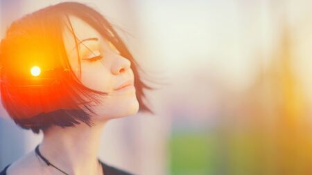 Double multiply exposure portrait of a dreamy cute woman meditating outdoors with eyes closed, combined with photograph of nature, sunrise or sunset. closeup. Psychology freedom power of mind concept