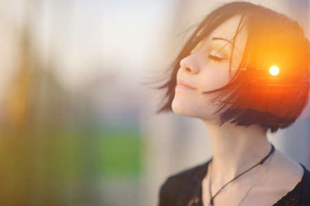 Double multiply exposure portrait of a dreamy cute woman meditating outdoors with eyes closed, combined with photograph of nature, sunrise or sunset, closeup. Psychology freedom power of mind concept Stock Photo