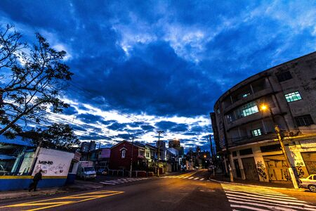Clouds and lights iver the street in town