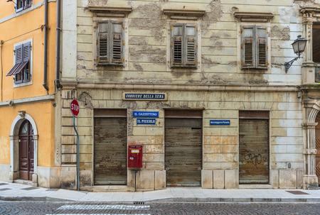 stucco house: Gorizia - Nova Gorica, May of 2015, Veneto region, Italy, Old Post office building, kiosk, Il Piccolo, Corriere della Sera, Messagero Veneto - newspapers Editorial