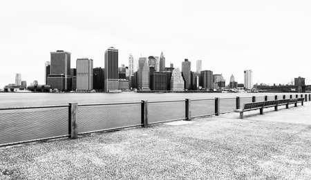 city park skyline: Manhattan skyline in cloudy day, black and white, view from Brooklyn Bridge Park, Pier 5, New York City, USA