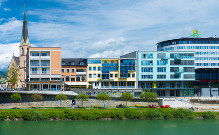 drava: Villach - May 2016, Austria: Old Church and modern buildings on bank of the river Drava in central part of the city