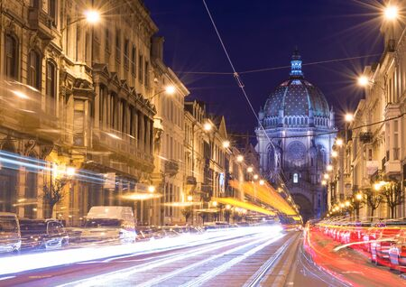 Brussels (Bruxelles) - February 2016, Belgium: Nigh view of the Belgian Capital, car light trails on Rue Royal street, view on Saint Marys Royal Church Editorial