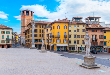 Udine - March of 2016, Italy: Old historical statues and colored houses in traditional architecture style on the Central Square of Liberty in Udine (Piazza della Liberta) Sajtókép