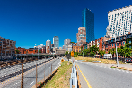 Boston - June 2016, USA: The street of Boston, view of John Hancock Tower, surrounding buildings and highway with traffic, Back Bay district