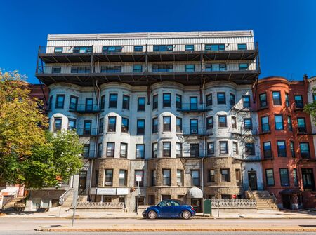 Boston - July 2016, MA, USA: Residential apartment building on one of the streets of Boston Back Bay neighborhood, unusual architecture style Redakční