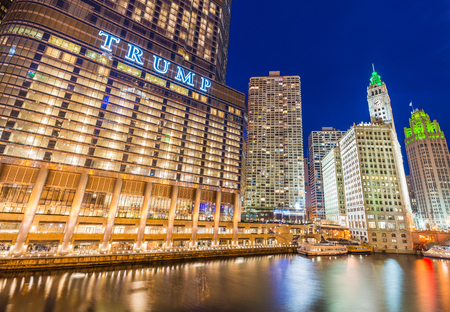 Chicago - March 2017, IL, USA: Downtown Chicago at night. View of Illuminated buildings in the central part of the city. Trump Tower and The Wrigley Building reflected in Chicago river Editorial
