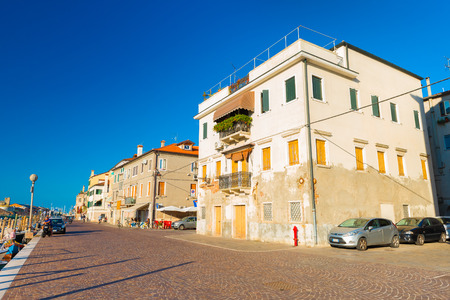 venice: Chioggia - September 2016, Veneto, Italy: Street view in wide angle view, old residential houses on the street of Chioggia - coastal town and comune of the City of Venice Editorial