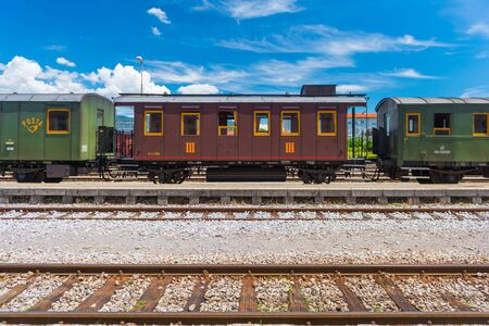 Nova Gorica (Gorizia) - June 2016, Italy: Vintage post-train cars on rails, old train at the station in Slovenian city of Nova Gorica. Sunny summer day