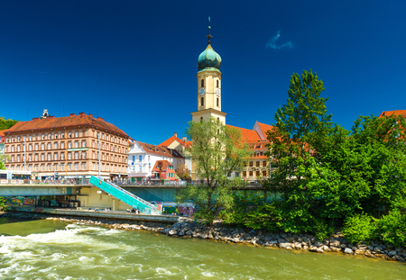 Graz - May 2017, Austria: Graz - May 2017, Austria: The old city center on sunny day. Franciscan Church, old historical buildings with orange roofs against the blue sky and the flowing river Mur Editorial