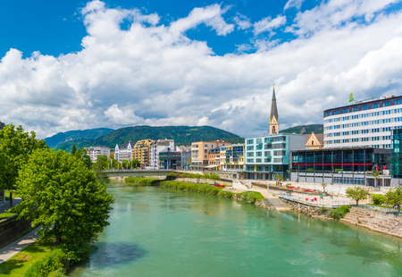 Villach - May 2016, Austria: Cityscape of the small Austrian city of Villach in sunny day, view of Drava river, historical buildings, hotels and Church in the old city center
