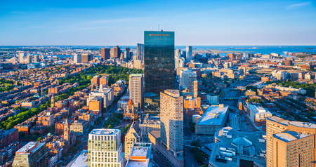 prudential: Boston - June 2016, Massachusetts, USA: Boston skyline at the evening. View on downtown and John Hancock Tower from the top of The Prudential Center in Back Bay Editorial