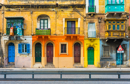 Malta, Valletta: Facade of a residential house with traditional maltese balconies.